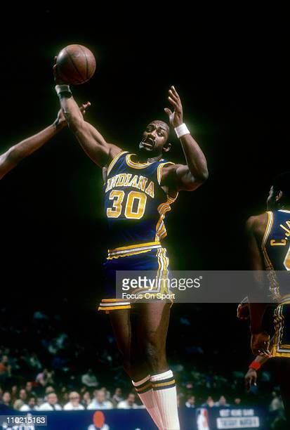George McGinnis of the Indiana Pacers pulls down a rebound gainst the Washington Bullets during an NBA basketball game circa 1980 at the Baltimore...
