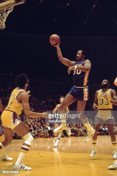 George McGinnis of the Philadelphia 76ers goes to the basket against the Los Angeles Lakers circa 1990 at the Great Western Forum in Inglewood...
