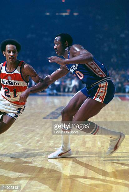 George McGinnis of the Philadelphia 76ers guards Dave Bing of the Washington Bullets during an NBA basketball game circa 1977 at the Baltimore Civic...