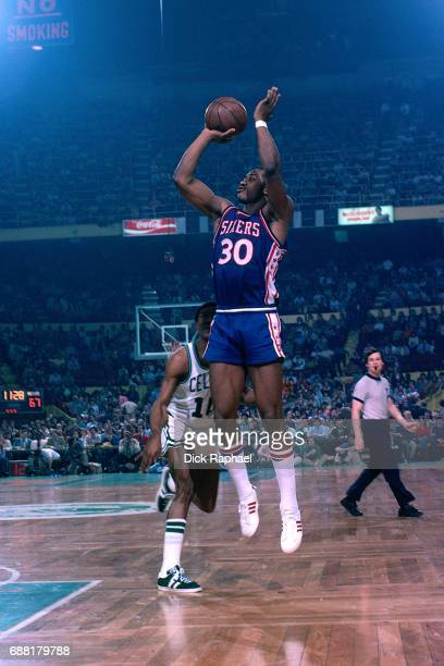 George McGinnis of the Philadelphia 76ers shoots the ball during a game against the Boston Celtics circa 1978 at the Boston Garden in Boston...