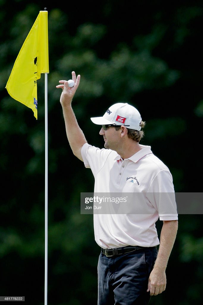 George McNeill acknowledges the crowd after hitting a hole in one on the eigth hole during the final round of the Greenbrier Classic at the Old White...