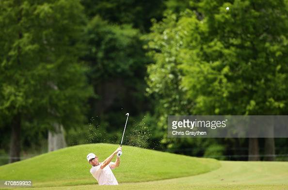 George McNeill chips out of the bunker on the seventh hole during round one of the Zurich Classic of New Orleans at TPC Louisiana on April 23 2015 in...