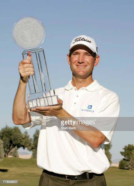 George McNeill holds the winner's trophy after the fourth round of the Fryscom Open benefiting Shriners Hospitals for Children at TPC Summerlin...