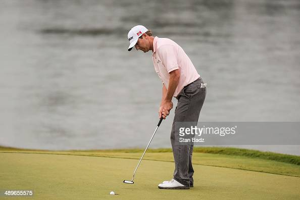George McNeill makes his putt on the 18th hole green during the final round of THE PLAYERS Championship on THE PLAYERS Stadium Course at TPC Sawgrass...