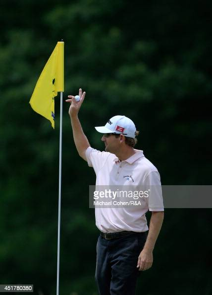George McNeill of the United States celebrates hi hole in one on the eighth hole during the final round of the Greenbrier Classic held at The Old...