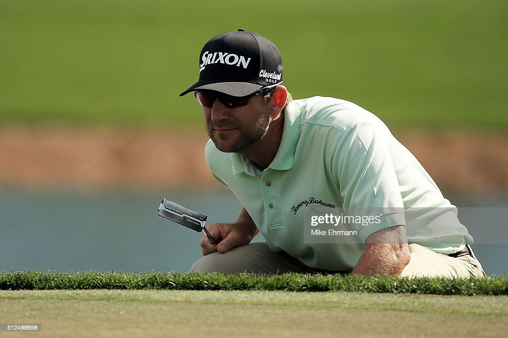George McNeill of the United States lines up a putt on the first hole during the second round of the Honda Classic at PGA National Resort Spa...