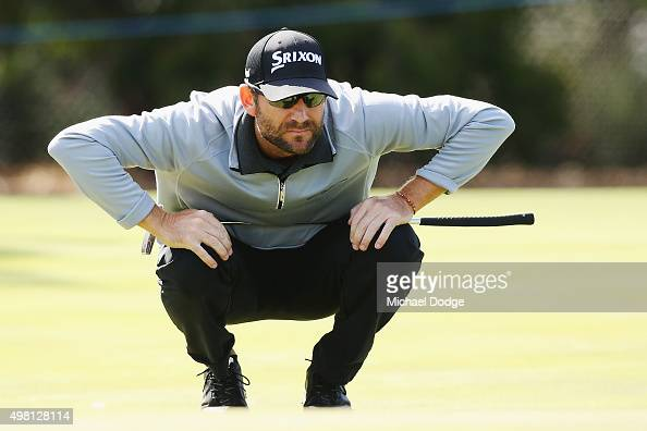 George McNeill of the USA lines up a putt during day three of the 2015 Australian Masters at Huntingdale Golf Club on November 21 2015 in Melbourne...