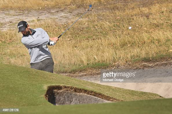 George McNeill of the USA plays out of the bunker during day three of the 2015 Australian Masters at Huntingdale Golf Club on November 21 2015 in...