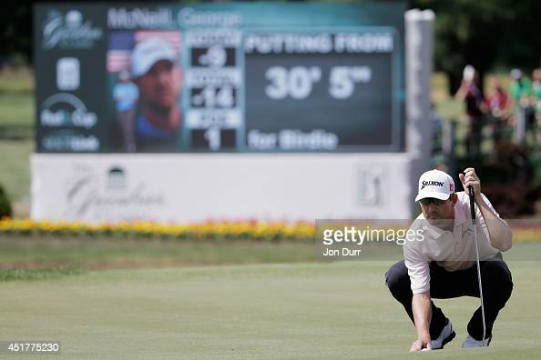 George McNeill sets up a putt on the 18th green during the final round of the Greenbrier Classic at the Old White TPC on July 6 2014 in White Sulphur...