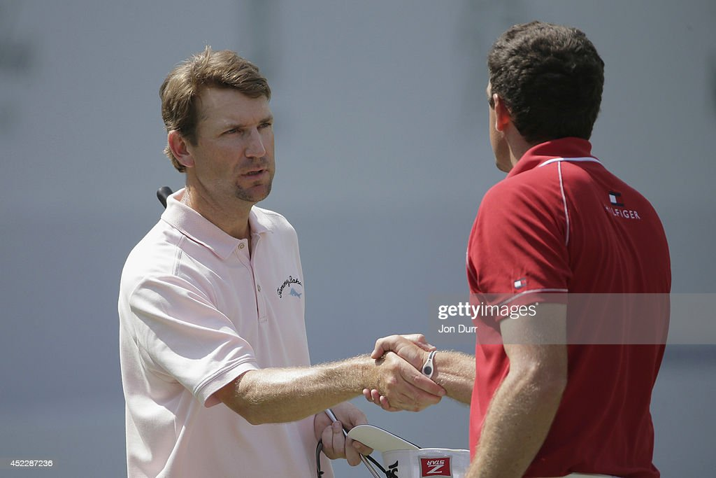 George McNeill shakes hands with Keegan Bradley after playing the 18th hole during the final round of the Greenbrier Classic at the Old White TPC on...