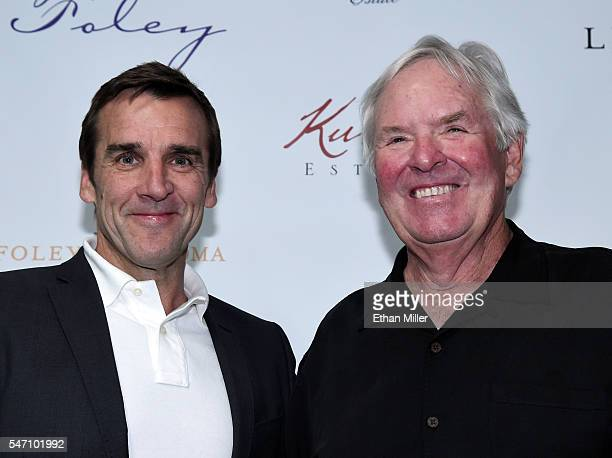 George McPhee poses with majority owner of the Las Vegas NHL franchise Bill Foley after he announced McPhee as the team's general manager during a...