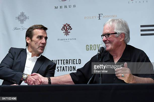 George McPhee shakes hands with majority owner of the Las Vegas NHL franchise Bill Foley after he announced McPhee as the team's general manager...