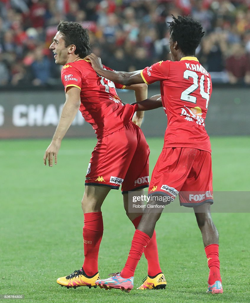 George Mells and Bruce Kamau of Adelaide United celebrates after United defeated the Wanderers during the 2015/16 A-League Grand Final match between Adelaide United and the Western Sydney Wanderers at Adelaide Oval on May 1, 2016 in Adelaide, Australia.