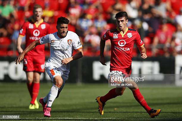 George Mells of Adelaide United competes with Brandon Borrello of Brisbane Roar during the round 21 ALeague match between Adelaide United and the...