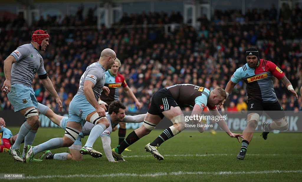 George Merrick of Harlequins breaks away to score a try during the Aviva Premiership match between Harlequins and Northampton Saints at Twickenham Stoop on February 6, 2016 in London, England.
