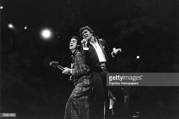 George Michael and Andrew Ridgeley of pop group Wham during a live performance Original Publication People Disc HL0194