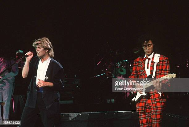George Michael and Andrew Ridgeley of the pop group Wham playing a concert at Beijing's People's Stadium This was the firstever gig by a Western pop...