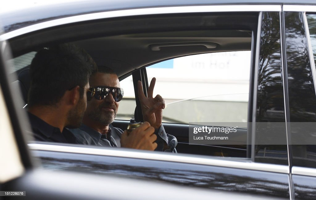 George Michael and Fadi Fawaz arrive at Airport Vienna on September 4, 2012 in Vienna, Austria.