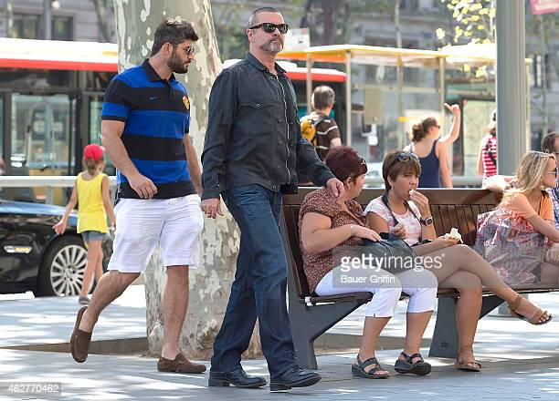 George Michael and his boyfriend Fadi Fawaz are seen on July 31 2012 in Barcelona Spain