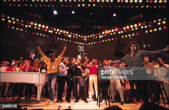 George Michael Bono Paul McCartney Freddie Mercury and Bob Geldof perform on stage during the Live Aid concert at Wembley Stadium on 13 July 1985 in...