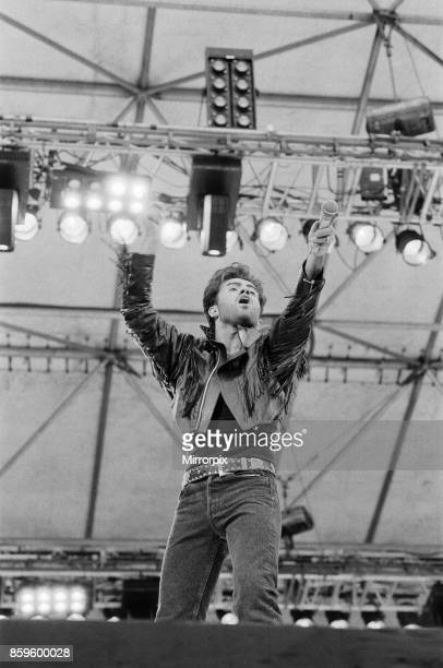 George Michael of Wham gets the crowd going at The Farewell Concert at Wembley Stadium London on 28th June 1986 George Michael's real name is...