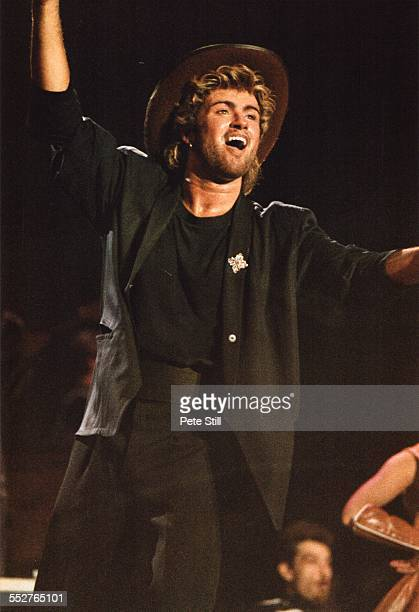 George Michael of Wham performs on stage at the National Exhibition Centre on February 27th 1985 in Birmingham England