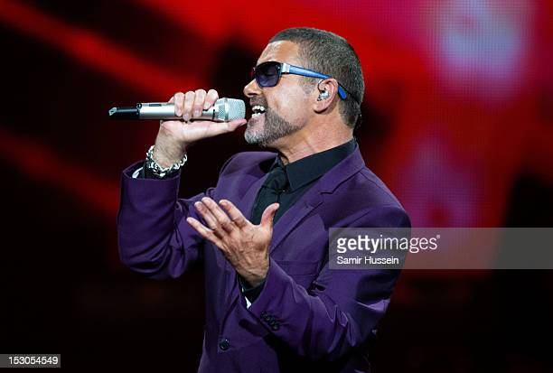 George Michael peforms at the Royal Albert Hall on September 29 2012 in London England