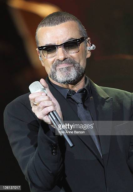 George Michael performs during the 'Symphonica Tour' at Palais Nikaia on September 22 2011 in Nice France