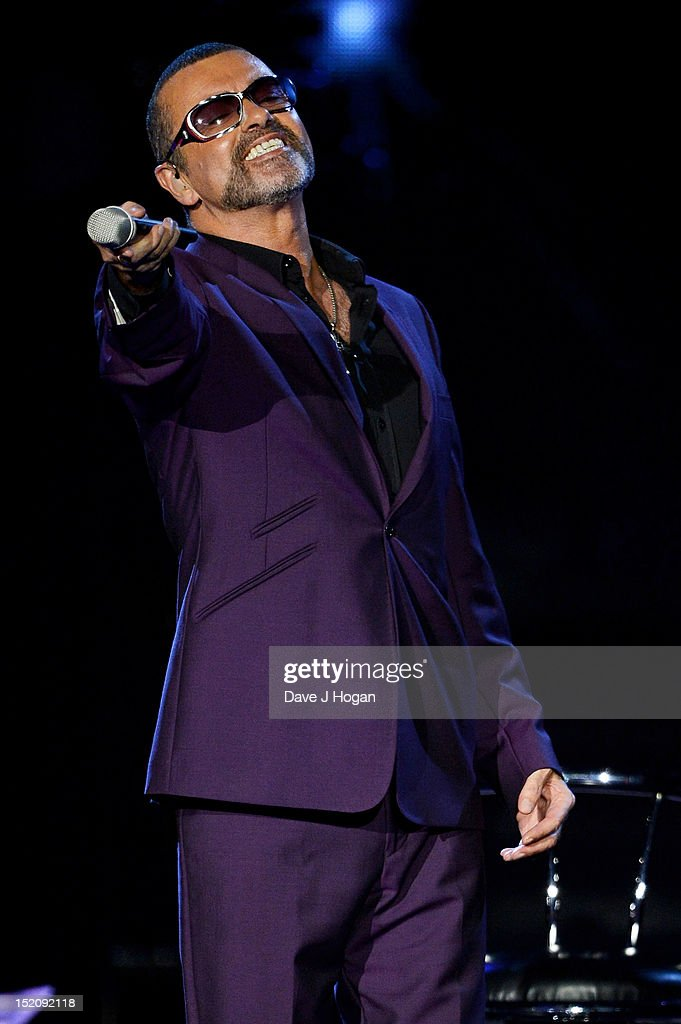 <a gi-track='captionPersonalityLinkClicked' href=/galleries/search?phrase=George+Michael&family=editorial&specificpeople=204670 ng-click='$event.stopPropagation()'>George Michael</a> performs on his Symphonica Tour at The LG Arena on September 16, 2012 in Birmingham, England.
