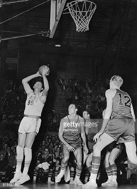 George Mikan of the Minneapolis Lakers marked his return to basketball after a two year retirement in last Saturday's game against Ft Wayne He is...