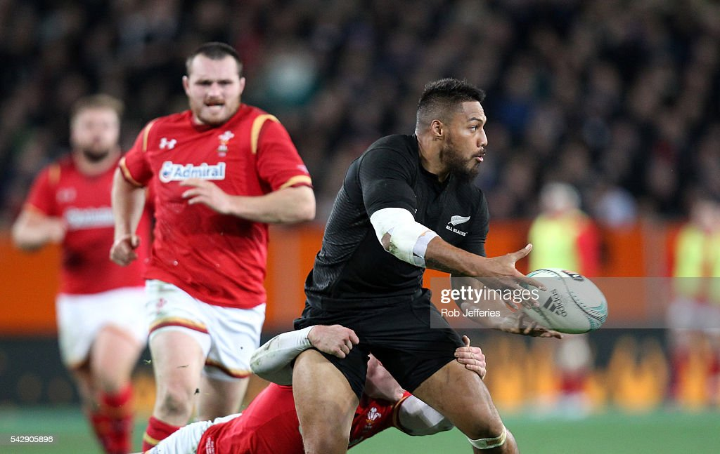 <a gi-track='captionPersonalityLinkClicked' href=/galleries/search?phrase=George+Moala&family=editorial&specificpeople=7060971 ng-click='$event.stopPropagation()'>George Moala</a> of New Zealand off-loads the ball during the International Test match between the New Zealand All Blacks and Wales at Forsyth Barr Stadium on June 25, 2016 in Dunedin, New Zealand.
