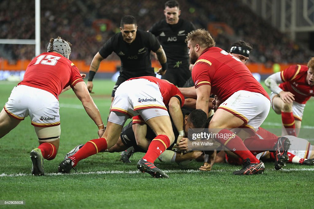 <a gi-track='captionPersonalityLinkClicked' href=/galleries/search?phrase=George+Moala&family=editorial&specificpeople=7060971 ng-click='$event.stopPropagation()'>George Moala</a> of the All Blacks scores a try during the International Test match between the New Zealand All Blacks and Wales at Forsyth Barr Stadium on June 25, 2016 in Dunedin, New Zealand.