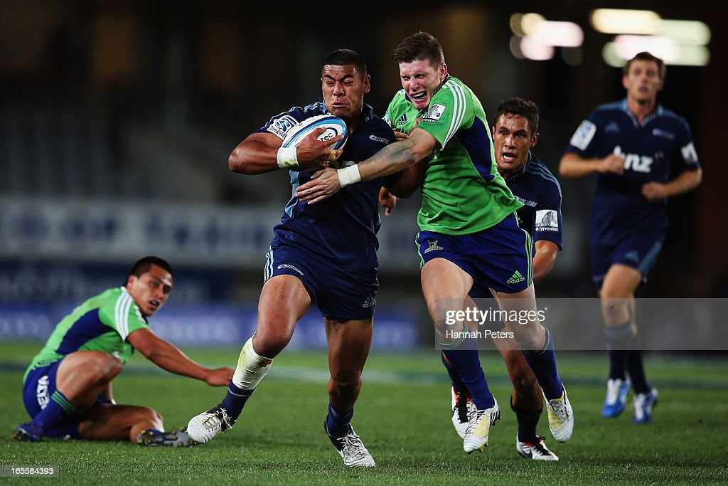 George Moala of the Blues fends off <a gi-track='captionPersonalityLinkClicked' href=/galleries/search?phrase=Colin+Slade&family=editorial&specificpeople=2270899 ng-click='$event.stopPropagation()'>Colin Slade</a> of the Highlanders during the round eight Super Rugby match between the Blues and the Highlanders at Eden Park on April 5, 2013 in Auckland, New Zealand.