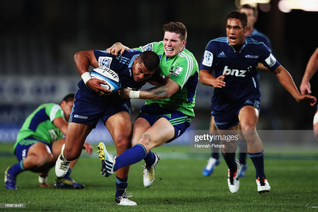 George Moala of the Blues fends off Colin Slade of the Highlanders during the round eight Super Rugby match between the Blues and the Highlanders at Eden Park on April 5, 2013 in Auckland, New Zealand.