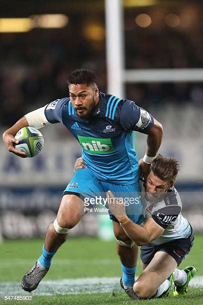 George Moala of the Blues is tackled by Rob Horne of the Waratahs during the round 17 Super Rugby match between the Blues and the Waratahs at Eden...