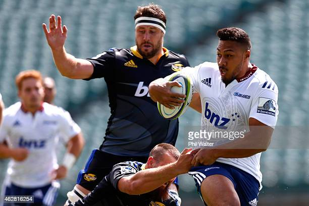 George Moala of the Blues is tackled during the Super Rugby preseason match between the Blues and the Hurricanes at QBE Stadium on February 6 2015 in...