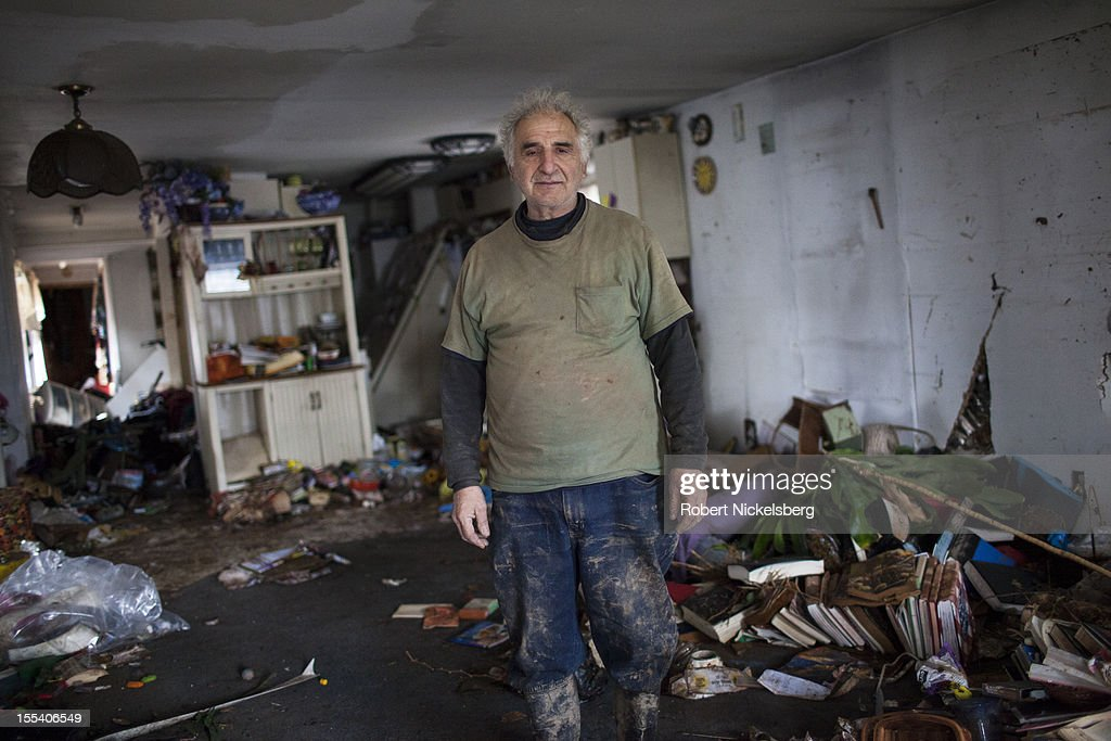George Morafetis stands in his ruined living room November 3, 2012 in Midland Beach after Superstorm Sandy left millions without power or water in the Staten Island borough of New York. The storm continues to affect business and daily life throughout much of the eastern seaboard.