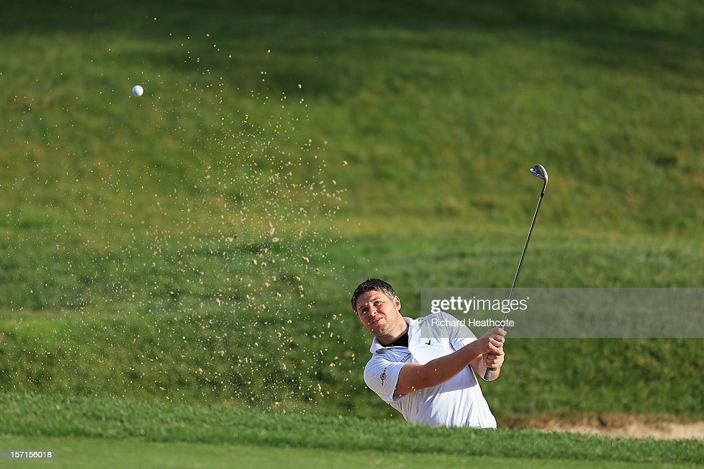 George Murray of Scotland plays from a greenside bunker on the 18th during the final round of the European Tour Qualifying School Finals at PGA Catalunya Resort on November 29, 2012 in Girona, Spain.