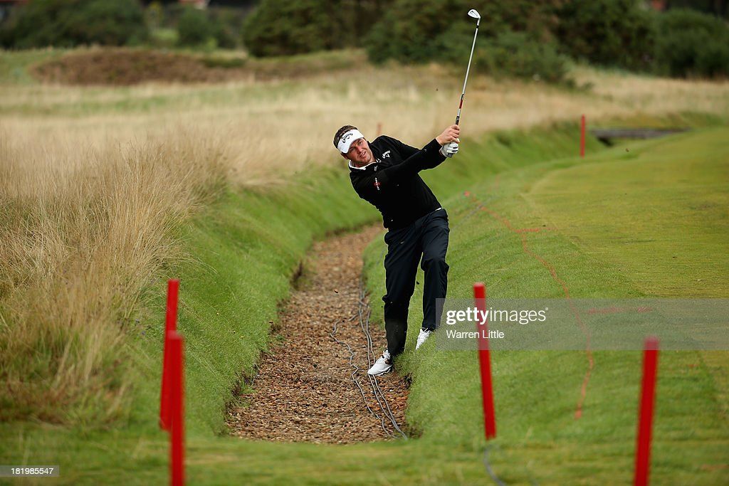 George Murray of Scotland plays out of a ditch on the 12th hole during the second round of the Alfred Dunhill Links Championship at the Championship Links on September 27, 2013 in Carnoustie, Scotland.