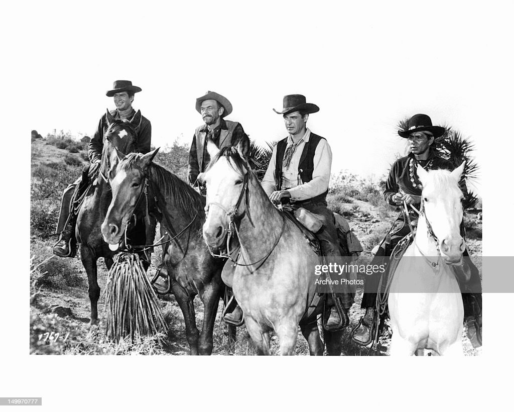 George Nader John McIntire Rory Calhoun and unidentified man on horseback in the same direction in a scene from the film 'Four Guns To The Border'...