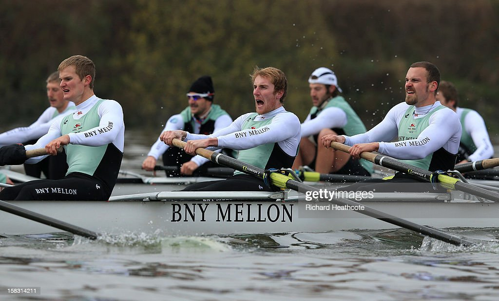 George Nash (c) of Cambridge tries to push his 'Mash' crew along during the trial 8's for The BNY Melon University Boat Race on The River Thames on December 13, 2012 in London, England.