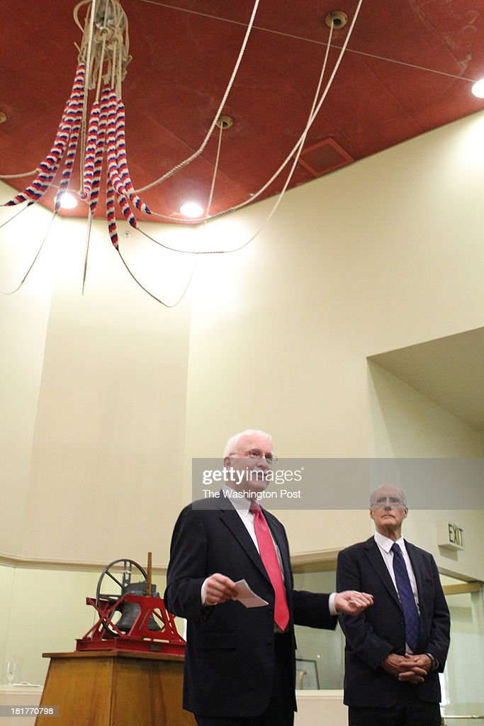 George Newcombe (left), a member of the American Ditchley board of directors, and Strobe Talbott, chairman of the board, under the ropes used to ring the bells, at the Old Post Office on Pennsylvania Avenue NW at Monday's celebration honoring the 30th anniversary of the Congress Bells, a gift from Sir David Wills.