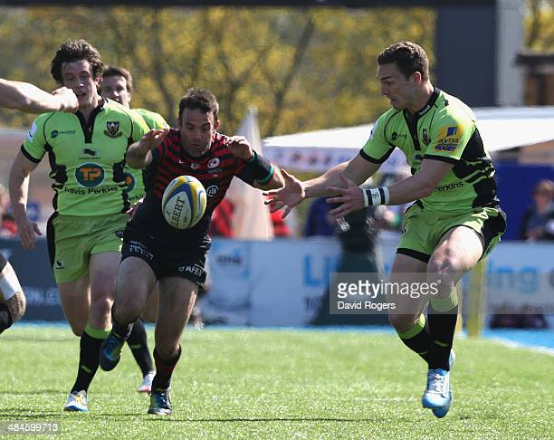 George North of Northampton attempts the gather the ball as Neil de Kock challenges during the Aviva Premiership match between Saracens and...