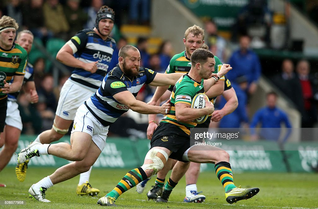 <a gi-track='captionPersonalityLinkClicked' href=/galleries/search?phrase=George+North&family=editorial&specificpeople=7320853 ng-click='$event.stopPropagation()'>George North</a> of Northampton charges upfield as Tom Dunn attempts to tackle during the Aviva Premiership match between Northampton Saints and Bath at Franklin's Gardens on April 30, 2016 in Northampton, England.
