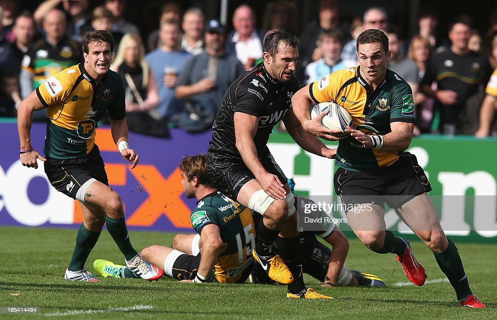 <a gi-track='captionPersonalityLinkClicked' href=/galleries/search?phrase=George+North&family=editorial&specificpeople=7320853 ng-click='$event.stopPropagation()'>George North</a> of Northampton charges upfield during the Heineken Cup pool 1 match between Northampton Saints and Ospreys at Franklin's Gardens on October 20, 2013 in Northampton, England.