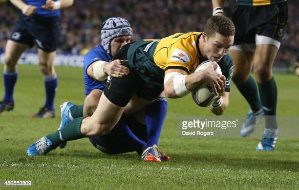 George North of Northampton dives over for the first try during the Heineken Cup pool 1 match between Leinster and Northampton Saints at the Aviva...