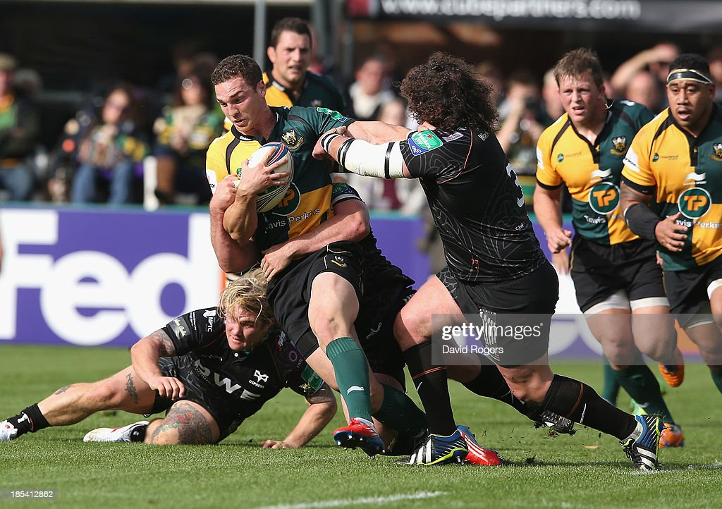 <a gi-track='captionPersonalityLinkClicked' href=/galleries/search?phrase=George+North&family=editorial&specificpeople=7320853 ng-click='$event.stopPropagation()'>George North</a> of Northampton is tackled by Adam Jones during the Heineken Cup pool 1 match between Northampton Saints and Ospreys at Franklin's Gardens on October 20, 2013 in Northampton, England.