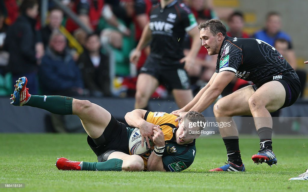 <a gi-track='captionPersonalityLinkClicked' href=/galleries/search?phrase=George+North&family=editorial&specificpeople=7320853 ng-click='$event.stopPropagation()'>George North</a> of Northampton is tackled by Ashley Beck during the Heineken Cup pool 1 match between Northampton Saints and Ospreys at Franklin's Gardens on October 20, 2013 in Northampton, England.