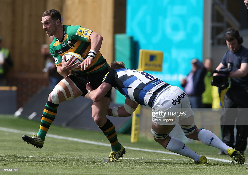 <a gi-track='captionPersonalityLinkClicked' href=/galleries/search?phrase=George+North&family=editorial&specificpeople=7320853 ng-click='$event.stopPropagation()'>George North</a> of Northampton is tackled by <a gi-track='captionPersonalityLinkClicked' href=/galleries/search?phrase=David+Denton+-+Rugbyer&family=editorial&specificpeople=12197244 ng-click='$event.stopPropagation()'>David Denton</a> during the Aviva Premiership match between Northampton Saints and Bath at Franklin's Gardens on April 30, 2016 in Northampton, England.