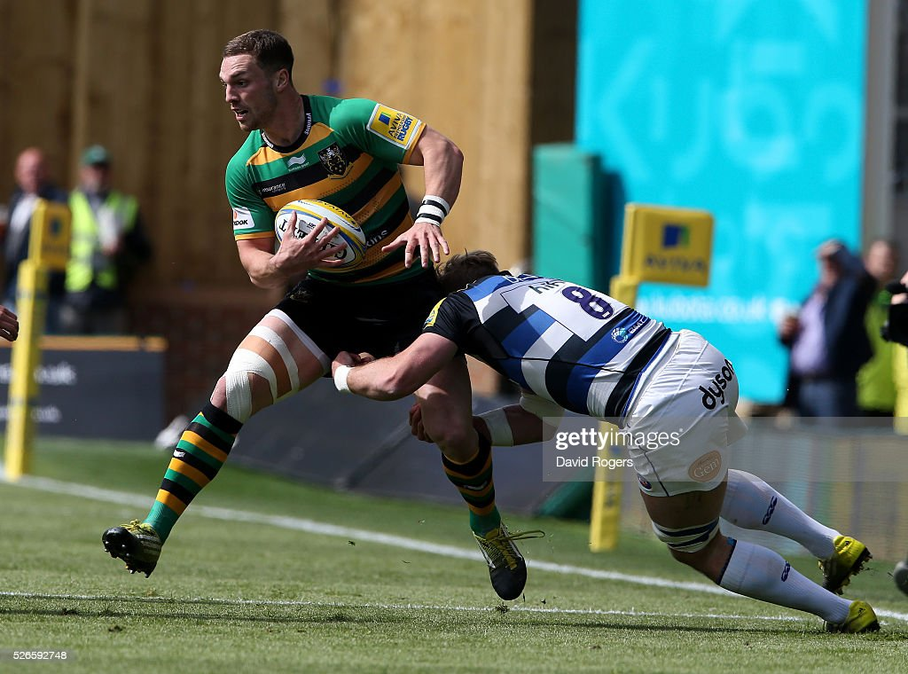 <a gi-track='captionPersonalityLinkClicked' href=/galleries/search?phrase=George+North&family=editorial&specificpeople=7320853 ng-click='$event.stopPropagation()'>George North</a> of Northampton is tackled by <a gi-track='captionPersonalityLinkClicked' href=/galleries/search?phrase=David+Denton+-+Rugbyspieler&family=editorial&specificpeople=12197244 ng-click='$event.stopPropagation()'>David Denton</a> during the Aviva Premiership match between Northampton Saints and Bath at Franklin's Gardens on April 30, 2016 in Northampton, England.
